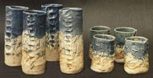 Mugs with Finger Grooves and pressed lizards